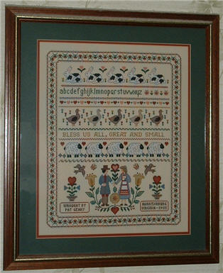 Bless Us All Counted Cross Stitch Sampler.