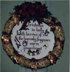 Photograph of Christmas Wreath Counted Cross Stitch.