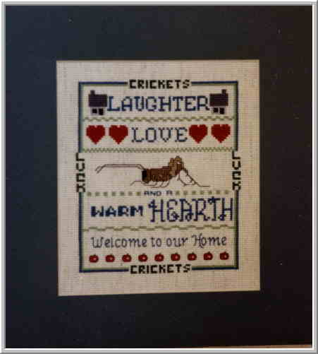 Photo of Cricket Counted Cross Stitch Sampler.