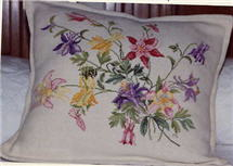 Eva Rosenstand counted cross stitch pillow.